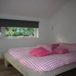 Tweede slaapkamer met tweepersoonsbed